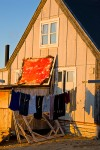 Muskox pelt and laundry hanging to dry outside an Inuit house